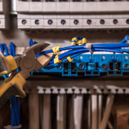 assembly-electrical-panel-electrician-job-robot-with-wires-circuit-breakers (1)