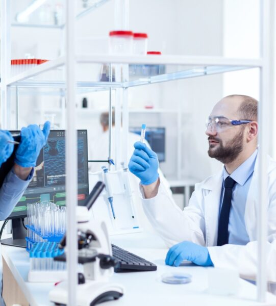 young-man-scientist-looking-pensive-chemical-solution-test-tubes-team-chemical-chemists-working-together-sterile-microbiology-lab-doing-research (1)